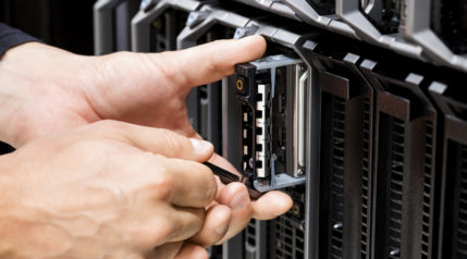 IT Technicians Hands Working On Server At Data Center